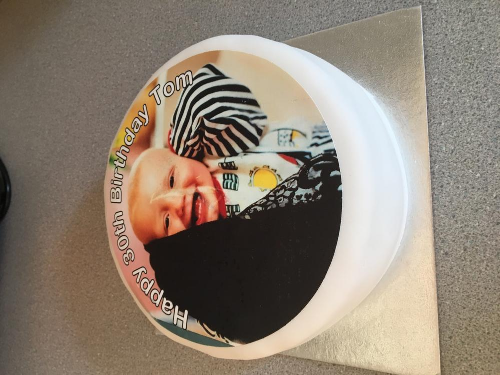 This is ESs cake I bought - the photo was made into edible icing - taken when he was about 18 months old !